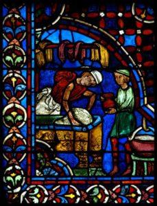 Art gothique. Chartres. Cathédrale Notre Dame. Déambulatoire. Verrière des Apôtres. Détail : boulanger pétrissant la pâte à pain pendant qu'un mitron lui tend une cruche d'eau. Vers 1210 1225. Vitrail.