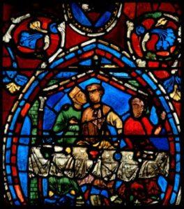 Art gothique. Chartres. Cathédrale Notre Dame. Transept. Verrière de l'Enfant prodigue. Le Fils prodique festoyant avec deux courtisanes. Vers 1205 1215. Vitrail.