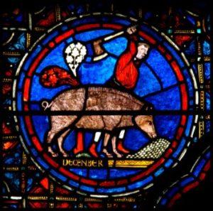 Art gothique. Chartres. Cathédrale Notre Dame. Verrière du zodiaque et des travaux des mois. Détail : novembre et le paysan qui tue le cochon. 1217 1220. Vitrail.