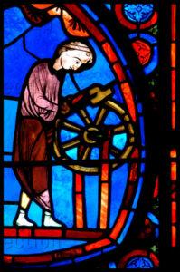 Art gothique. Bourges. Cathédrale St Etienne. Verrière de l'histoire de Joseph. Détail : charron équarissant une roue. Vers 1210 1215. Vitrail.