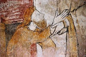 Art Gothique. Lubersac. Eglise St-Etienne. Saint Léonard libérant un prisonnier. Détail : le prisonnier. XIIIe siècle. Peinture murale.
